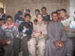 Capt. Christine Hauser, an F-18 Hornet weapons system officer who volunteered to help with civil affairs in Fallujah, poses with kids during the MEDCAP mission to Albu Aifan. Photo courtesy of Jodie Sweezey