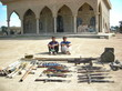 "The ""Blue Bongo Brothers"" in front of a mosque with weapons and ammunition captured from their vehicle and home during a raid on the village of Hawa on Mar. 3, 2007. Photo courtesy of Jeremiah Howe"